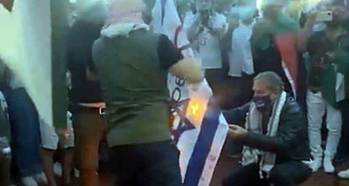 Pro-Palestinian-protesters-burning-the-Israeli-flag-at-Nathan-Philip-Square-May-15-2021-Photo-Facebook-Hanita-Braun